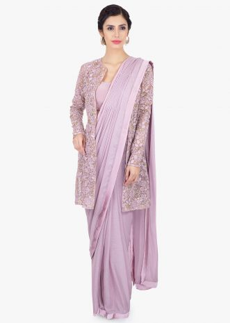 Lavender shimmer chiffon pre stitched saree paired with a long  embroidered net jacket