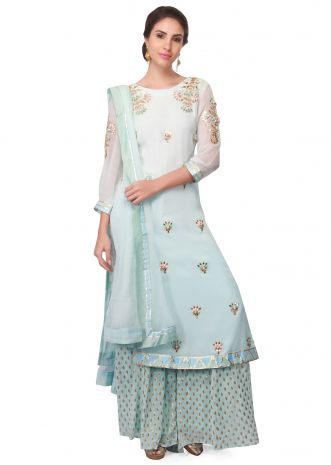 Light blue straight suit embellished in resham and gotta lace only on Kalki