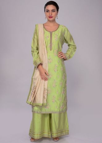 Light green cotton silk palazzo suit set with contrasting cream dupatta