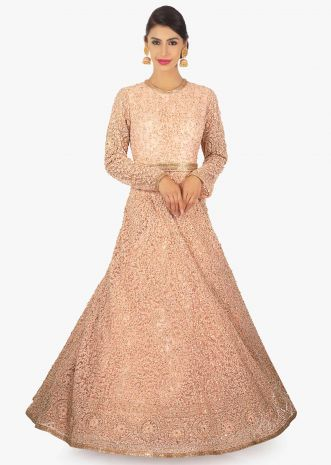 Light peach anarkali gown in thread work along with cut dana and sequins