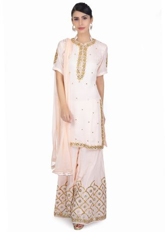 Light peach gotta patch embroidered suit paired with matching palazzo and chiffon dupatta