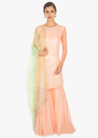 Light peach sharara set paired with a contrasting mint green organza net dupatta