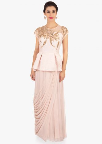 Light peach soft net gown with peplum style bodice