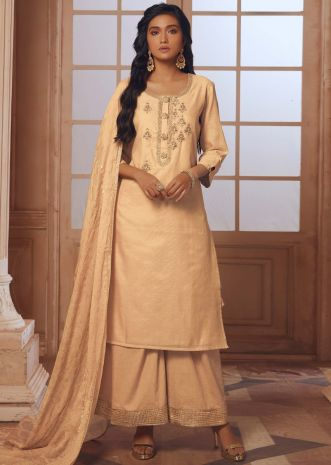 Light peach straight palazzo suit with embroidered butti and fancy buttons