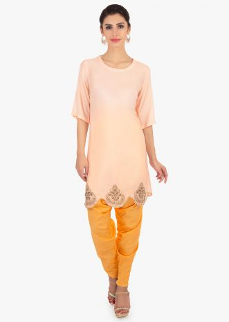 Light peach top paired with a yellow dhoti pant