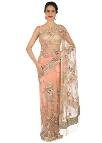 Light peach saree in net with resham and velvet floral embroidery