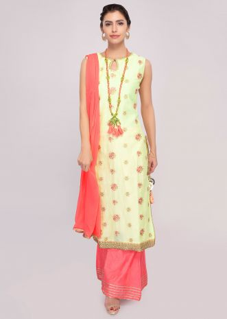 Lime yellow cotton suit paired with peach palazzo and shiffon dupatta