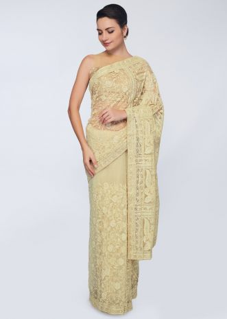 Lime yellow saree featuring in net in jaal embroidery