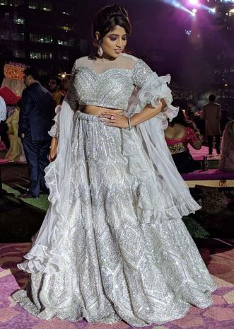 Malishka in Kalki embroidered grey organza lehenga set with ruffle dupatta.