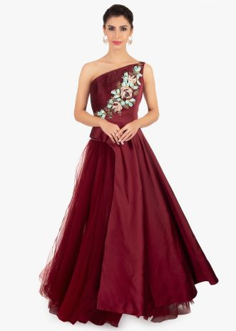 Maroon satin floor length top paired with matching net skirt in satin lining