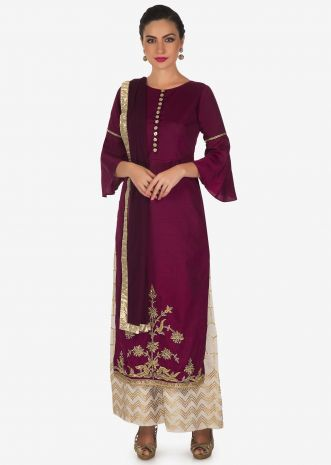 Maroon straight suit in embroidered hem line with cream palazzo only on Kalki
