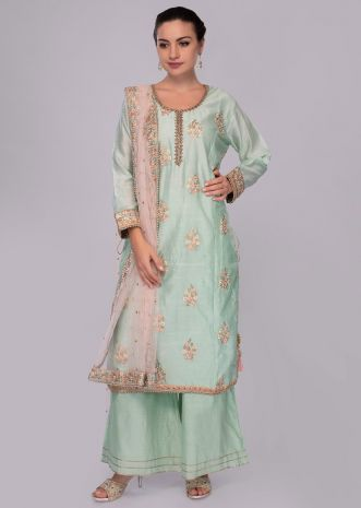 Mint green floral embroidered palazzo suit set with pink net dupatta.