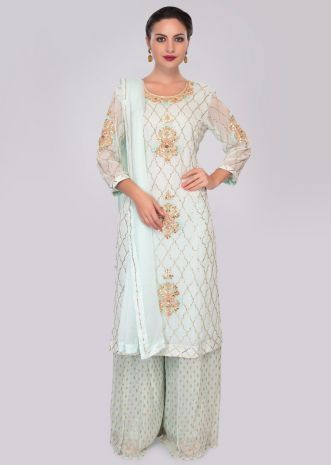 Mint green georgette suit in embroidery and butti paired with weaved palazzo