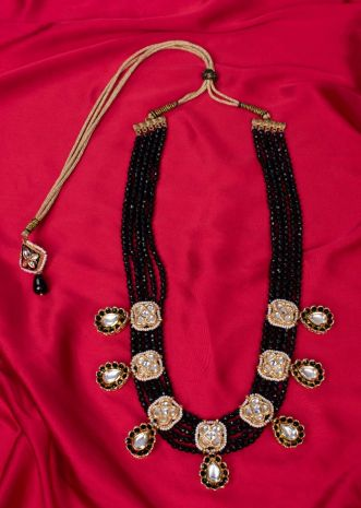 Multi string layer black faceted bead traditional necklace with floral pendant only on Kalki