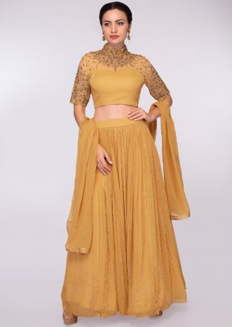 Mustard georgette lehenga with illusion neck blouse in zardosi and kundan embroidery