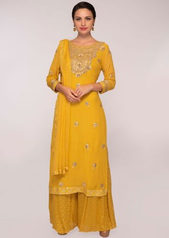 Mustard georgette suit in gotta patch embroidery and butti in floral motif