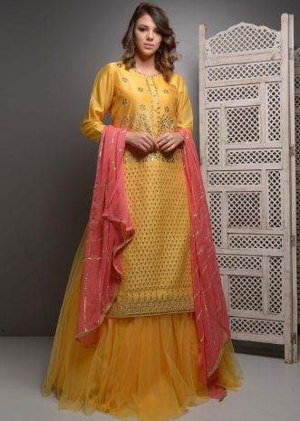 Mustard gotta patti embroidered suit with matching net skirt