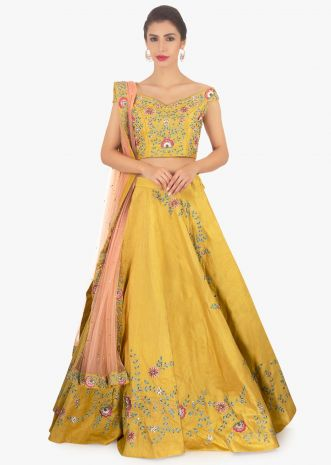 Mustard raw silk lehenga and blouse paired with pink net dupatta