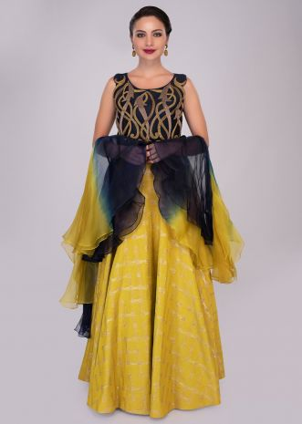 Mustard skirt paired with persian blue sequins embroidered blouse and ruffled organza dupatta