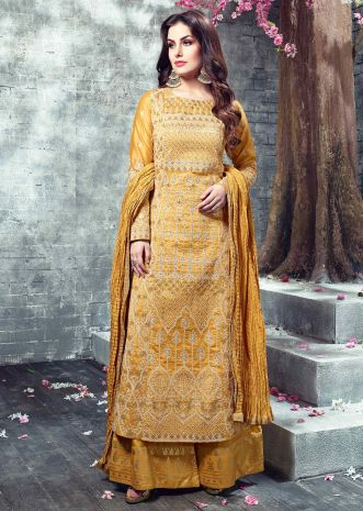 Mustard thread embroidered suit paired with foil printed pant and crushed cotton dupatta