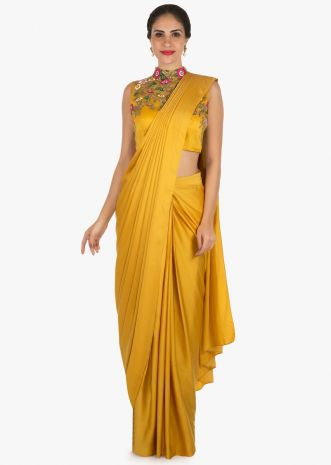 Mustard ready pleated saree with a high neck blouse embellished in resham and moti work only on Kalki
