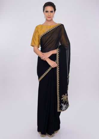 Navy blue georgette saree with contrasting mustard blouse only on kalki