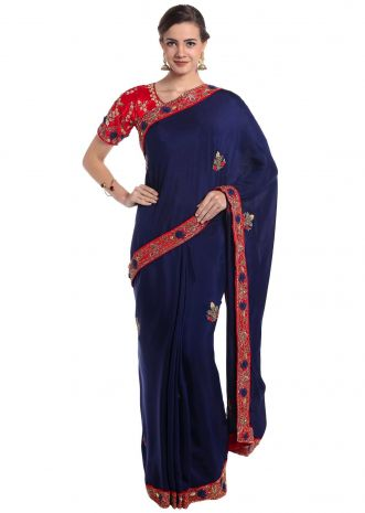 Navy blue satin saree adorned with resham and cut dana work only on Kalki
