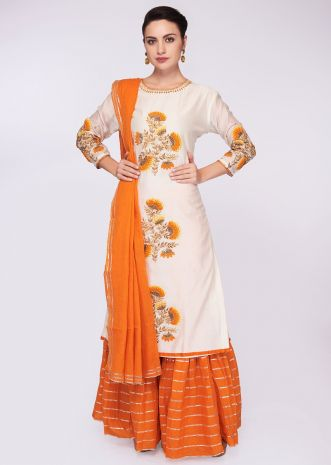 Off white cotton kurti with center butti paired with orange sharara pant