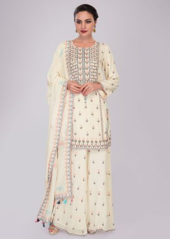 Off white cotton suit and palazzo in embroidery and butti