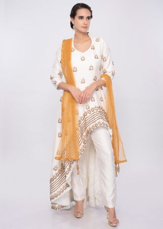 Off white front short back long embroidered suit with yellow net dupatta only on Kalki