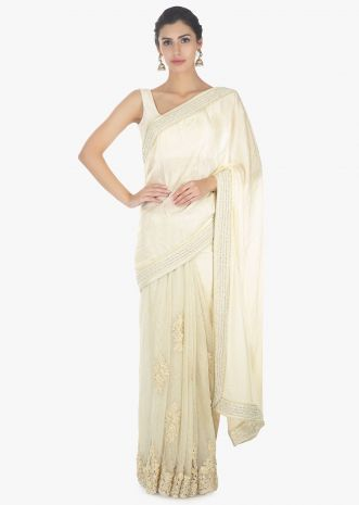 Off white half and half saree in chiffon and net saree with embellished scallop border