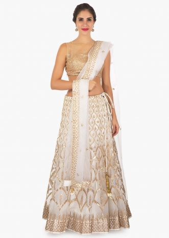 Off white organza lehenga with gotta patch all over with a net dupatta only on Kalki