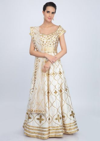 Off white raw silk anarkali suit with golden embroidery only on Kalki