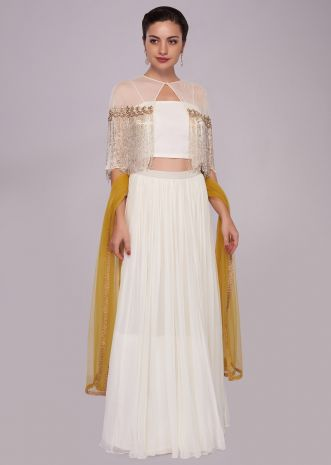 White georgette skirt with crop top blouse and tassel embroidered cape