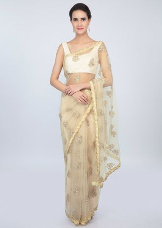 Pale cream sheer net saree with butti and embroidered scallop border only on kalki