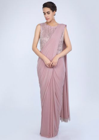 7b5874e850ebaf Pale pink lycra net ready pleated saree with heavy embellished tasseled  blouse only on Kalki ...