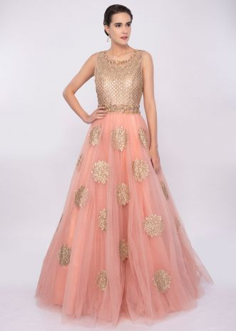 Pale pink voluminous pink net gown with butti only on Kalki