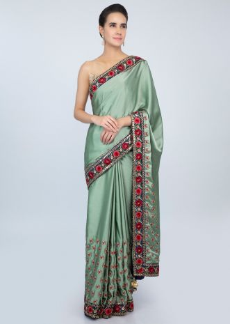 Paris green satin saree in multi color floral resham embroidery only on kalki