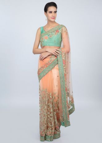 Pastel Peach sheer net saree in heavy floral jaal embroidery only on kalki