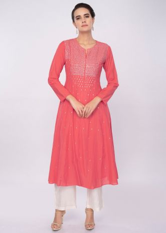 Peach cotton kurti adorn with sequins work only on Kalki