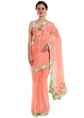 Peach crepe silk saree crafted with zardosi work  only on Kalki