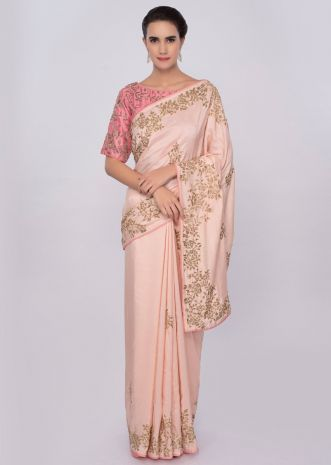 Peach cut dana embroidered saree with contrasting punch pink blouse