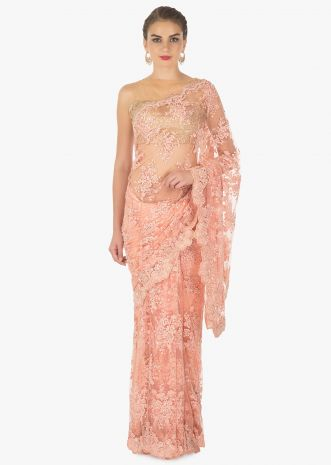 Peach embroidered net saree in sequin and moti