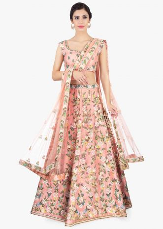 Peach raw silk embroidered lehenga and blouse paired with net dupatta