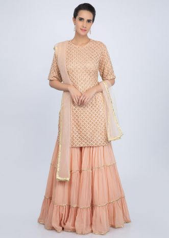 Peach sharara suit set in embroidered jaal work only on Kalki