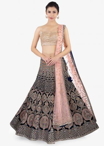 Peacock green  heavily embellished lehenga set paired with a pink net dupatta