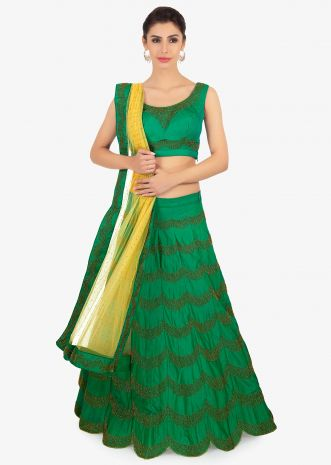 Peacock green silk lehenga and blouse with  beige net dupatta
