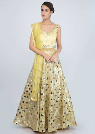 Pine yellow net anarkali gown with applique work only on Kalki