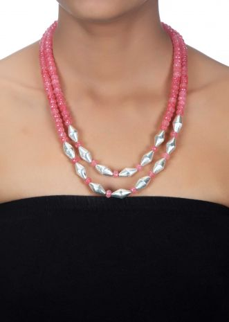Pink bead necklace along with twisted oval silver beads