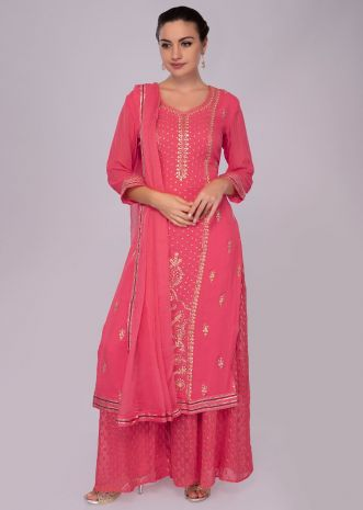 Pink georgette suit with zari embroidery in center panel and side butti